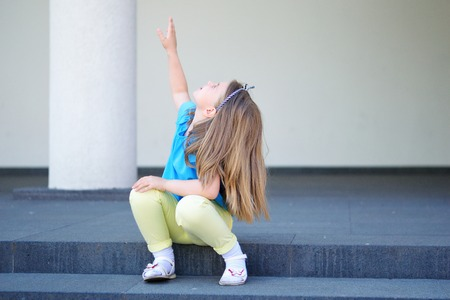Adorable girl point out to something in the sky Stok Fotoğraf