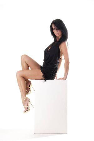 gorgeous sitting on a white cube Stock Photo