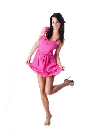 hermosa dama en un vestido rosa posando sobre fondo blanco  Foto de archivo