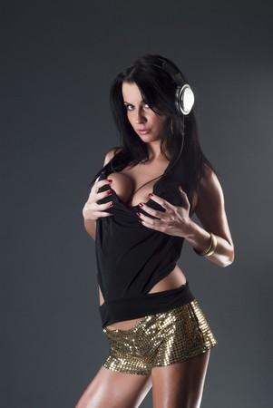 Sexy dama con bola de disco brillante  Foto de archivo