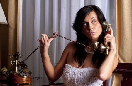 beatifull bride with antique phone photo