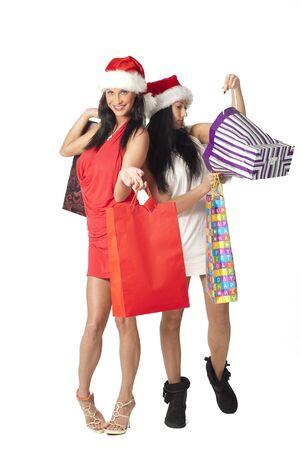 Dos ladys hermosos con bolsas de compra Foto de archivo