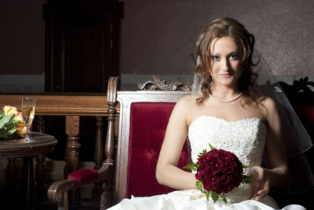 Beautiful bride sitting on a sofa