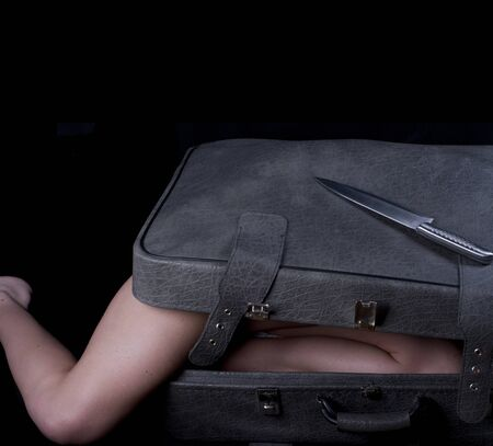 Dead blonde body in suitcase Stock Photo - 8796874