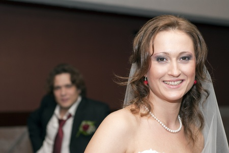Smiling bride and groom behind her Stock Photo
