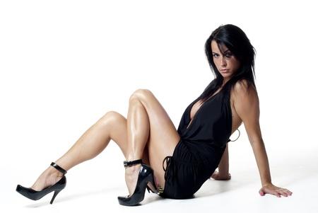 Sexy lady sentada en un suelo Foto de archivo