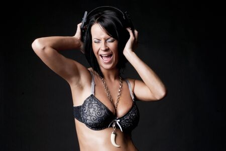 Sexy lady in lingerie with headphones Stock Photo