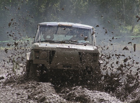 Offroad car driving in the dirt