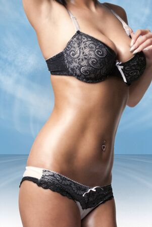 Beautiful body over ocean and sky Stock Photo