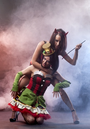 Two sexy ladies in costumes Stock Photo