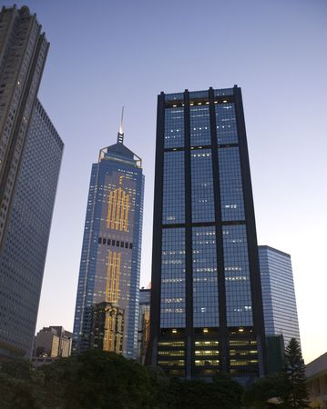 wan: Downtown office buildings in Wan Chai, Hong Kong, in the late sunset before evening. Beautiful blue sky