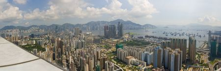 congested: Panorama of Hong Kong and Kowloon from Mong Kok. Foreground features dense apartment blocks, Victoria Harbour and Hong Kong Central Business District.