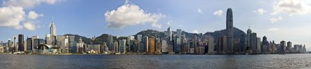 hong kong people: Hong Kong panorama of city on a beautiful blue sky day. Victoria Harbour from Kowloon Stock Photo