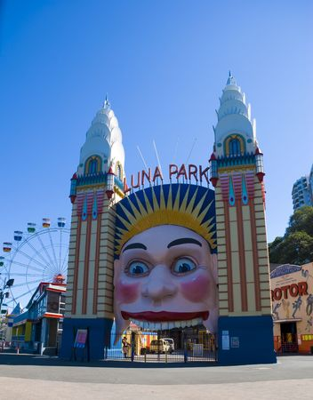 Entrance to Luna park Amusement Park Sydney Australia with Ferris Wheel in the background, on a beautiful clear blue day.
