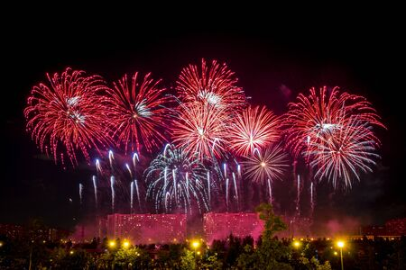Red Fireworks light up the sky