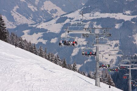 Skiers on skilift with frost trees montains. Ski resort in Europe