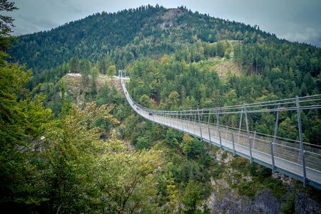 Suspension Bridge highline179 at Reutte between two hills in beautiful landscape Scenery of Alps, Tirol, Austria