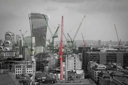 Construction cranes in a modern city London. Black and withe cityscape Imagens