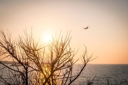 Sunset in Crete, Greece amid a landing plane at Iraklion airport Banco de Imagens