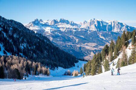 Sunny winter landscape at Ski Area in Dolomites, Italy - Alpe Lusia. Ski resort in val di Fassa near Moena. Winter Dolomites and blue sky. Aerial view on ski slopes 版權商用圖片