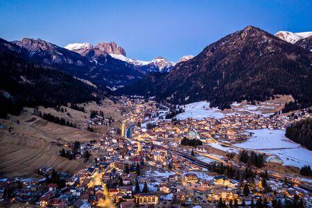 Night aerial view of Pozza di Fassa, a commune in Trentino at the northern Italia. Val di Fassa, Dolomiti