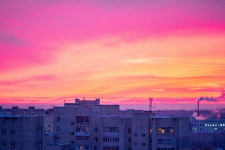 The sunset scarlet clouds. City building 스톡 콘텐츠