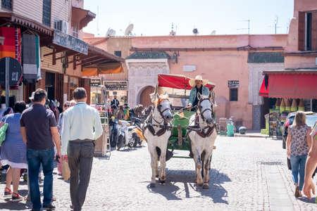 MARRAKESH, MOROCCO - APRIL 10, 2019: People in a market of medina of Marrakesh