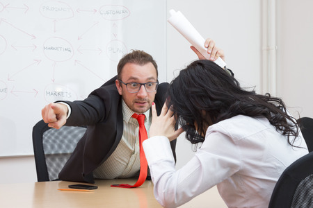 conflicts: Angry boss firing female colleague by showing the door with his forefinger