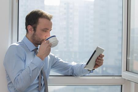 read news: Businessman on a coffee break