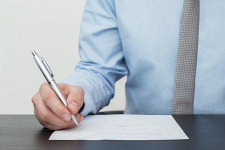 pen and paper: Close-up of businessman signing a contract Stock Photo