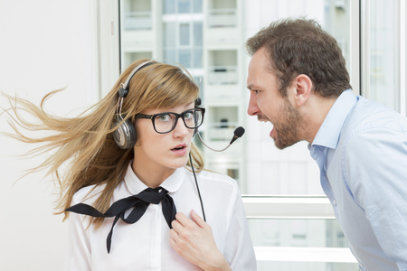 sex discrimination: Boss yelling at his female assistant Stock Photo