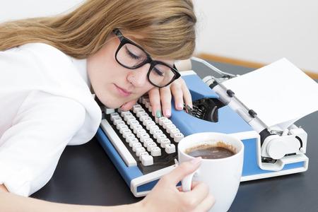 tired: Tired writer sleeping on typewriter Stock Photo