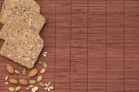 nourish: Wholemeal bread and nuts top down perspective Stock Photo