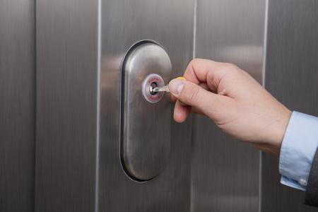 Person unlocking the emergency lock on the elevator    Foto de archivo