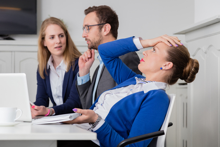 Young female professional does not agree with the opinion of her colleagues on a business meeting 版權商用圖片