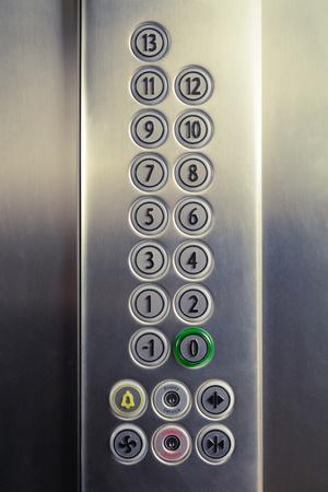 Different buttons in modern metal elevator Banco de Imagens - 96754385