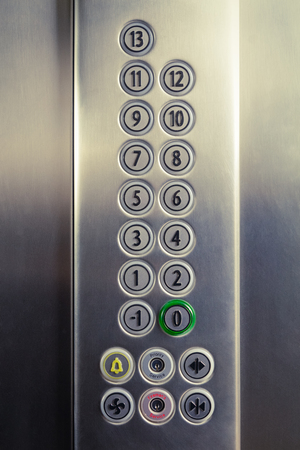 Different buttons in modern metal elevator