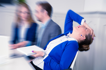Young female professional does not agree with the opinion of her colleagues on a business meeting Stock Photo
