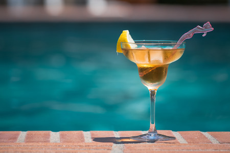 Cocktail on the edge of swimming pool