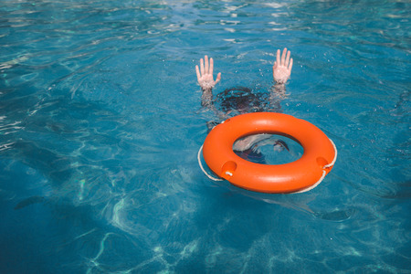 Female and lifebelt in water. Drowning help assistance concepts. Archivio Fotografico