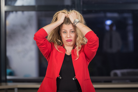 Portrait of depressed businesswoman pulling her hair out. She is upset because of business problems. Stok Fotoğraf
