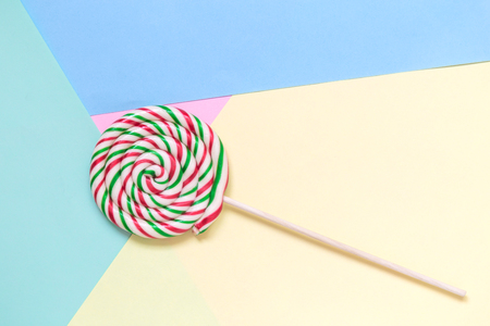 Lollipop on colorful pastel background minimal creative concept. Reklamní fotografie