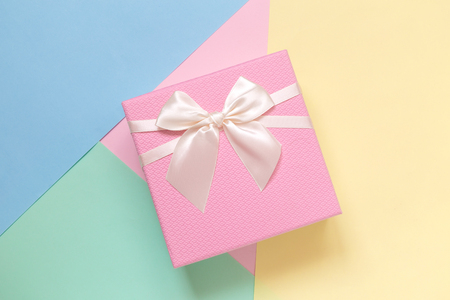 Gift box on colorful pastel background minimal creative concept