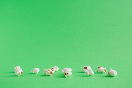 Popcorn on pastel green background minimal creative concept. Space for copy. Stock Photo