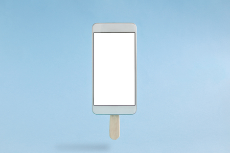Mobile phone in form of ice cream isolated on pastel blue background minimal concept.