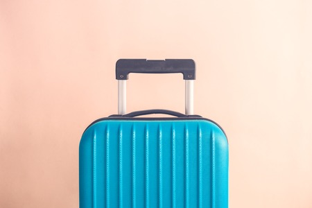 Suitcase on pastel beige background minimal creative travel concept Reklamní fotografie