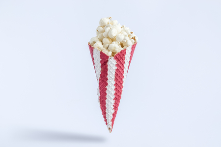 Ice cream cone with popcorn isolated on white background minimal creative concept.