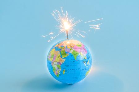Globe grenade isolated on blue minimal creative concept Reklamní fotografie