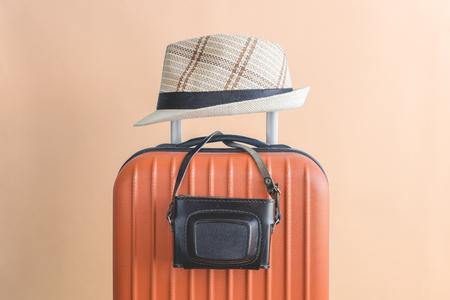 Suitcase with hat and retro camera. Travel equipment minimal creative concept. 版權商用圖片