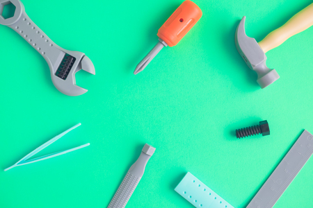 Set of carpentry tools toy on green background minimal creative concept. Stock Photo